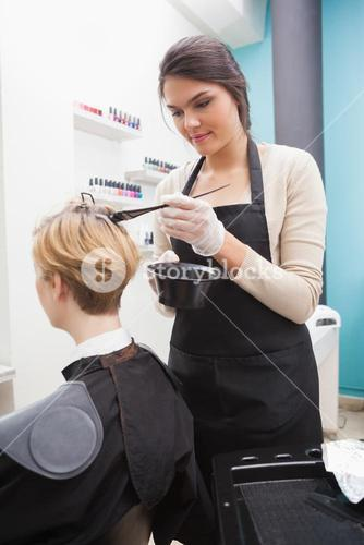 Hairdresser preparing hair colour