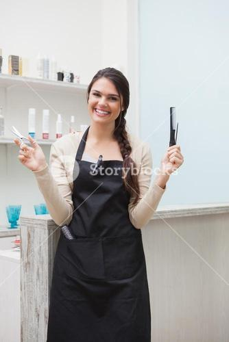 Cheerful hairdresser looking at camera
