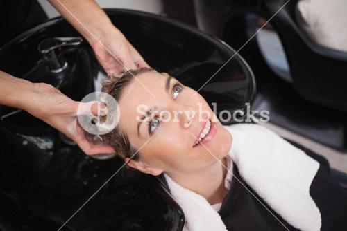 Customer getting their hair washed