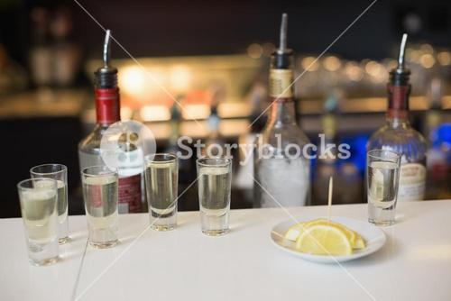 Tequila shots and lemon slices