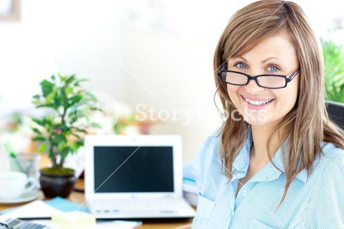 Blond businesswoman smiling at the camera