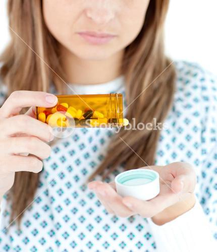 Close up of female patient taking pills