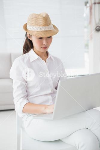 Hipster businesswoman sitting and using laptop