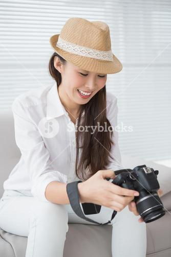 Photo editor looking at her camera
