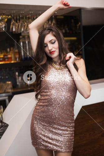 Pretty brunette dancing with hands up