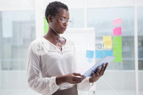 Businesswoman with glasses using tablet