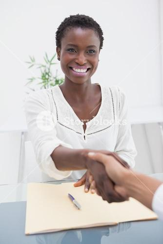 Smiling businesswoman introduced her new colleague