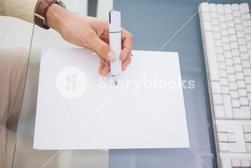 Hand of a businessman writing with a marker