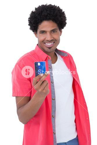 Happy man holding credit card