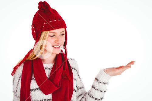 Festive blonde presenting with hand
