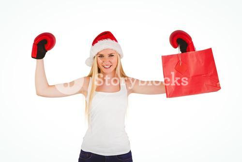 Festive blonde cheering with boxing gloves