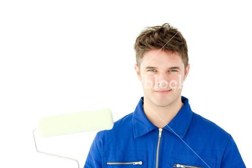 Goodlooking male worker smiling at the camera