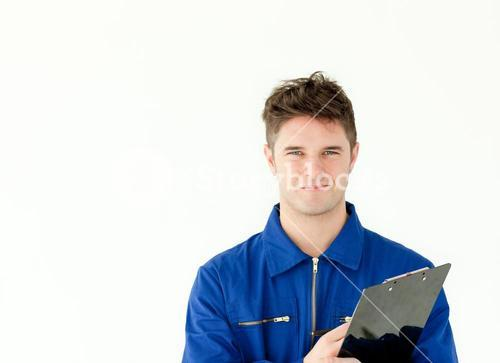 Goodlooking male worker holding a document