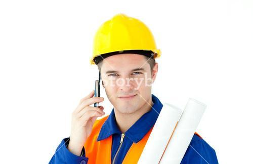 Young male worker wearing helmet