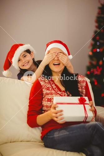 Daughter surprising her mother with christmas gift