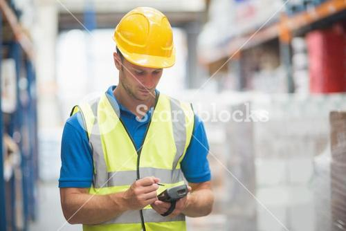 Worker using hand held computer