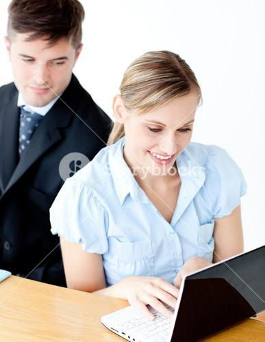 Beautiful young businesswoman using her laptop at home