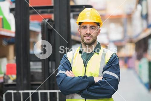 Manual worker wearing hardhat and eyewear