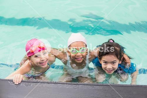 Cute little kids in the swimming pool