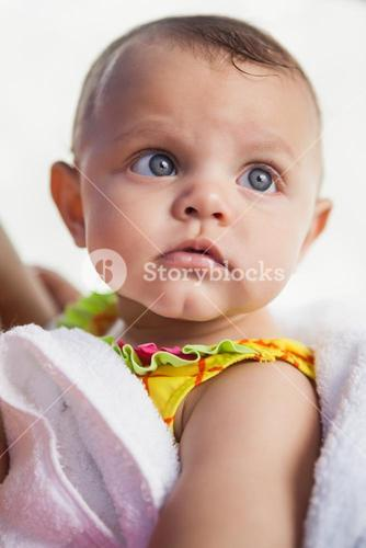 Cute baby wrapped in towel
