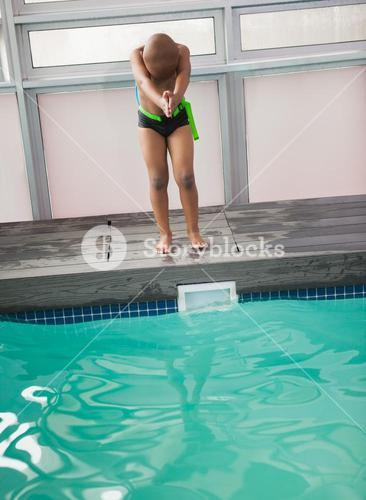 Little boy ready to dive in pool