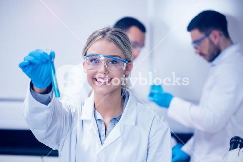 Science student holding up test tube