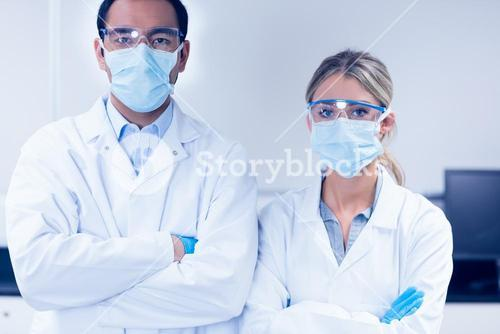 Science students wearing protective masks