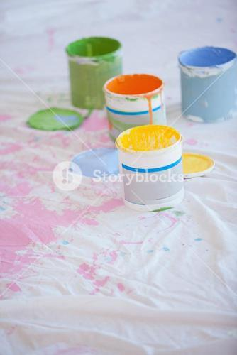 Different paint cans on the floor