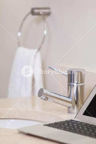 Close up of laptop on the sink