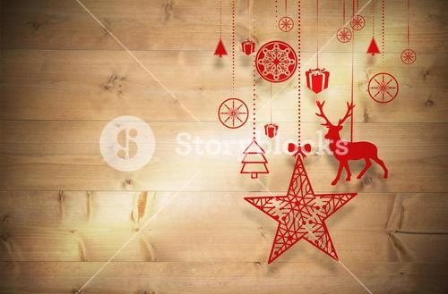 Composite image of hanging red christmas decorations