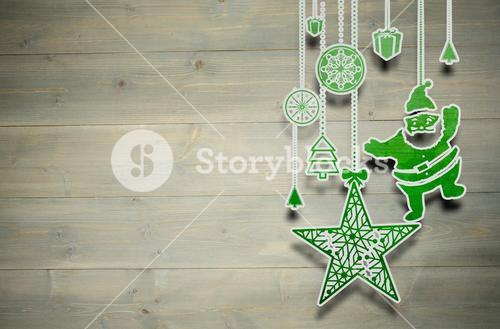 Composite image of hanging christmas decorations