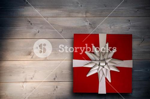 Composite image of christmas present with bow