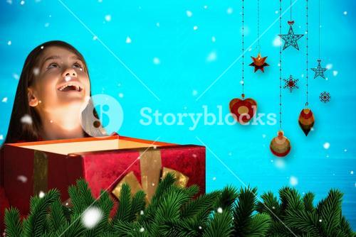 Composite image of happy girl opening gift box