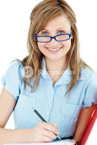 Ambitious businesswoman taking notes smiling at the camera