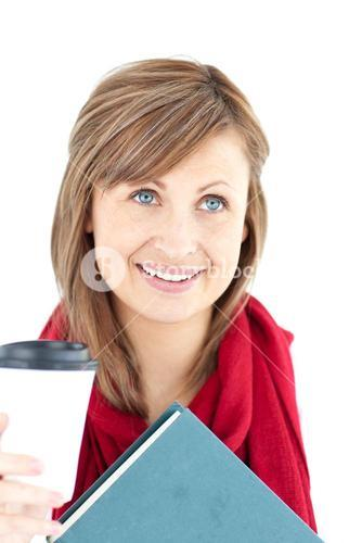 Radiant woman holding a book and coffee