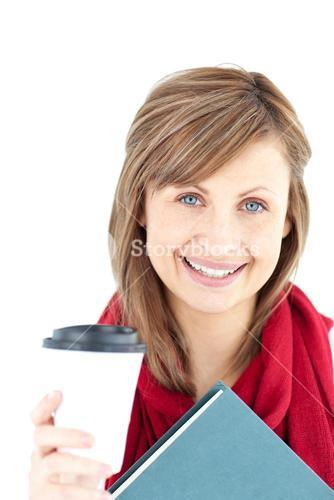 Cheerful woman holding a book and coffee