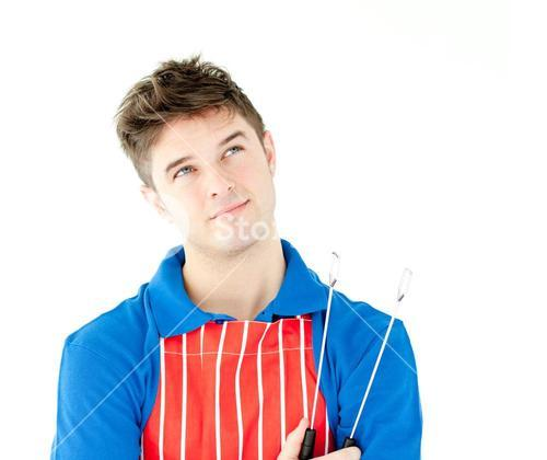 Thougtful young cook holding a cookware