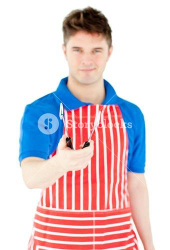 Handsome young cook holding a cookware