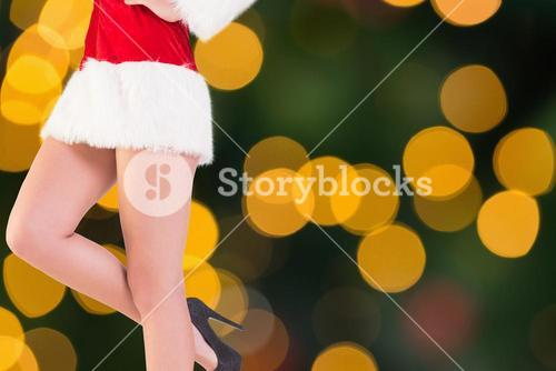Composite image of festive womans legs in high heels