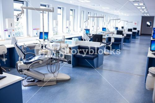 Inside of the clinic with dentists chairs