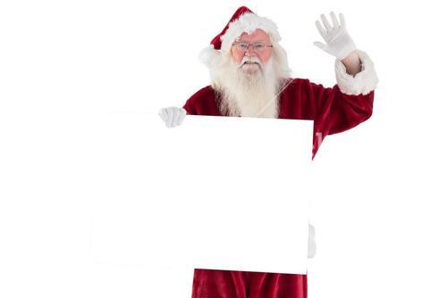 Santa holds a sign and is waving