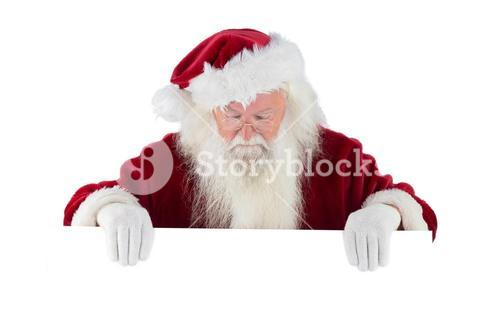 Santa holds a sign and looks down