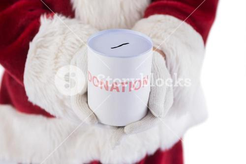 Santa holds a can for donations