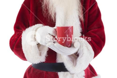 Santa holds a red cup