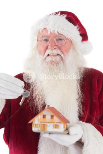 Santa hands the key to a tiny house