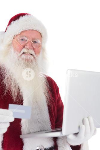Santa pays with credit card on a laptop