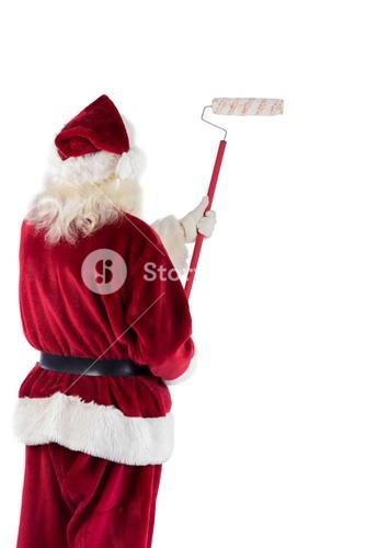 Father Christmas paints a wall