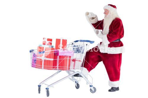 Santa pushes a shopping cart while reading