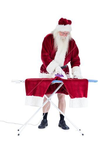Santa is ironing his pants