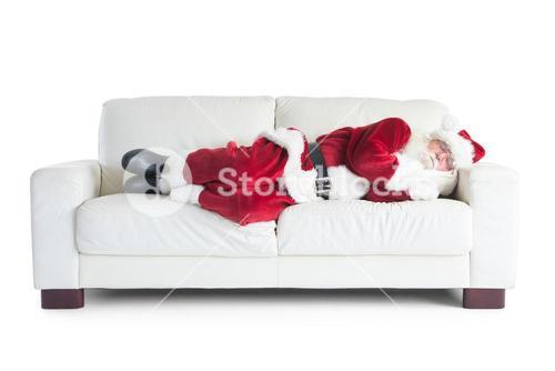 Father Christmas sleeps on a couch
